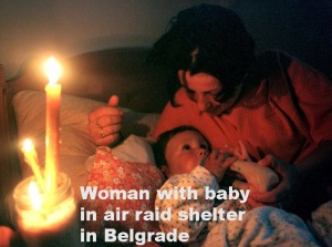 A BELGRADE WOMAN FEEDS HER BABY IN A SHELTER.