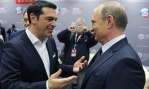 Russian President Vladimir Putin, right, and Greek Prime Minister Alexis Tsipras speak at an economic forum in St. Petersburg, Russia, Friday, June 19, 2015. Russia is willing to consider giving financial aid to Greece, a Russian government official said Friday ahead of talks between the leaders of the two countries. (Mikhail Klimentyev/RIA-Novosti, Kremlin Pool Photo via AP)