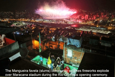 the-mangueira-favela-community-watches-fireworks-explode-over-maracana-stadium-during-the-rio-olympics-opening-ceremony
